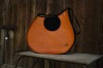 janis pomarańczowy brąz główne logo